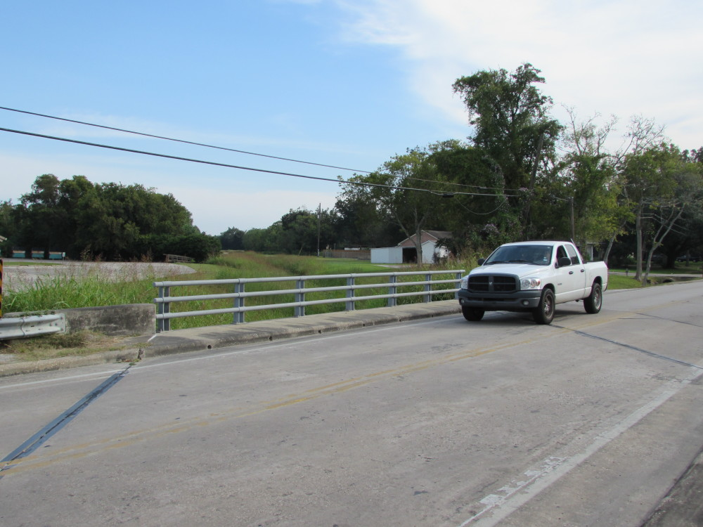 A truck passes over a bridge built by Harris County on Runneburg Road in Crosby. (Photo: Gail Delaughter, Houston Public Media)