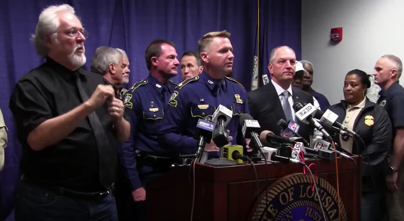 Officials gather in Baton Rouge on Sunday after a gunman shot and killed 3 law enforcement officers and wounded 3 more.