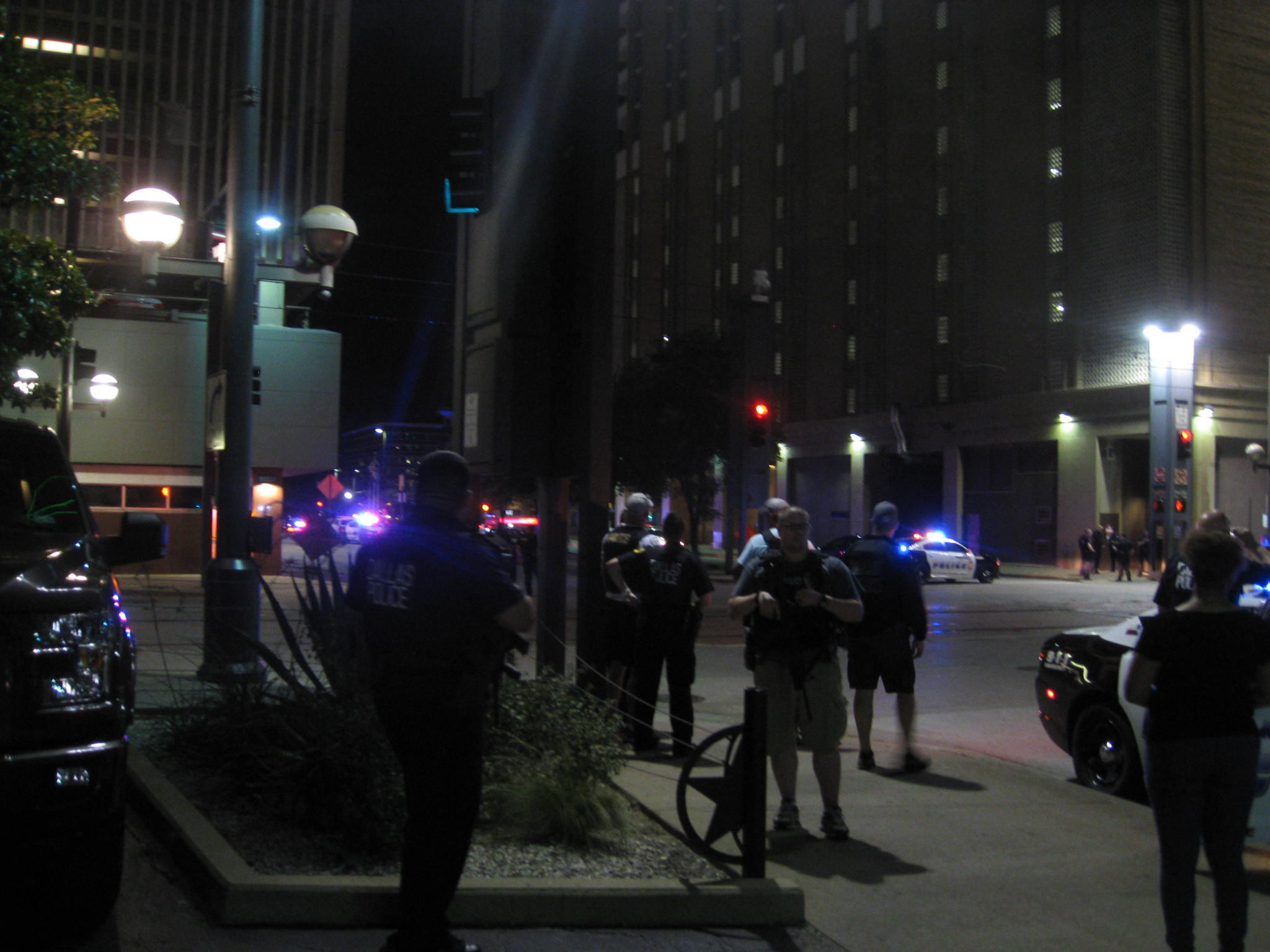 Police flooded downtown Dallas following a shooting that left at least four officers dead.