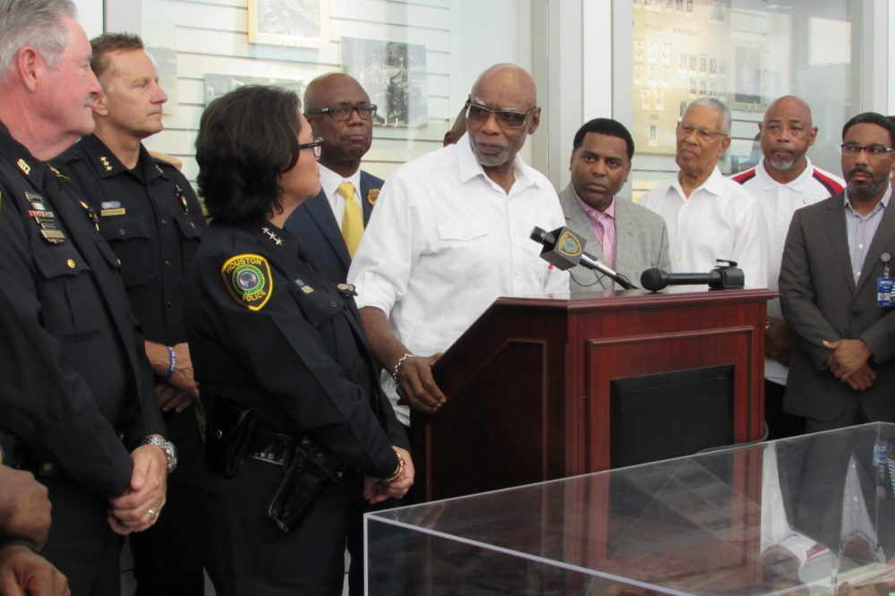 Houston NAACP President Dr. James Douglas speaks at a prayer vigil at HPD headquarters.