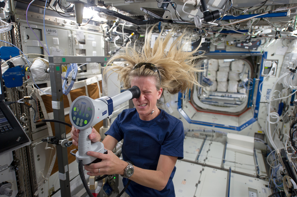 Visual Impairment Intracranial Pressure Syndrome was identified in 2005 and is currently NASA's leading spaceflight-related health risk. Here, NASA astronaut Karen Nyberg of NASA uses a fundoscope to image her eye while aboard the space station.