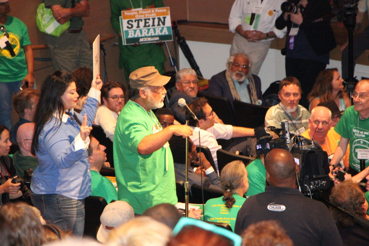 Delegate Herb Gonzales (at microphone) of San Antonio casts Texas' votes at the Green Party presidential nominating convention at the University of Houston. (Photo: Andrew Schneider, Houston Public Media)