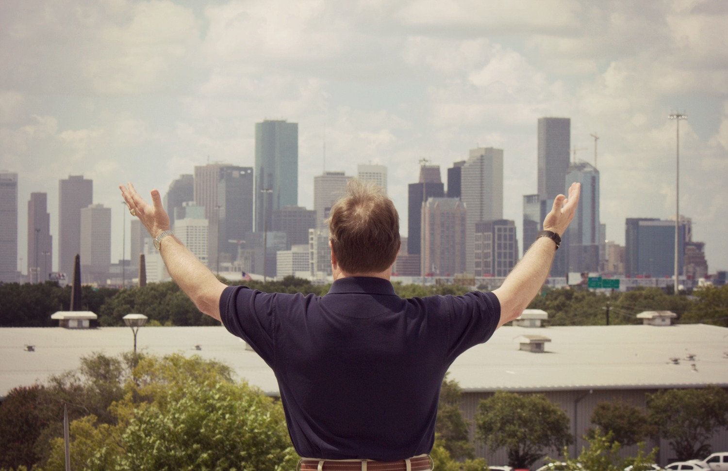 Houston Public Media's Paul Pendergraft is retiring after some 30 years in radio, including 20 at KUHF/News 88.7. He's pictured atop the Melcher Center for Public Broadcasting on the University of Houston campus. (Photo: Mark DiClaudio, Houston Public Media)