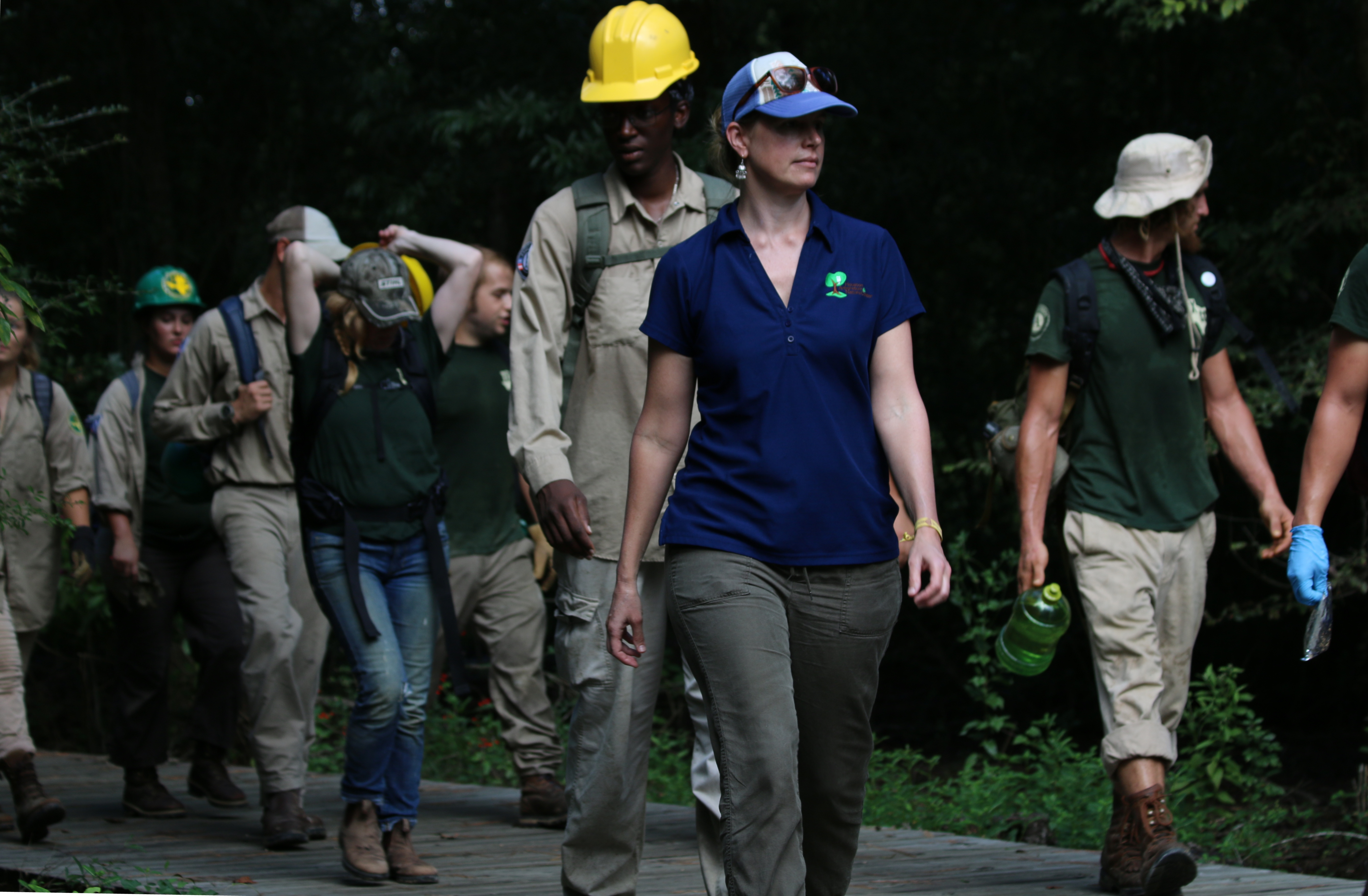 Houston Arboretum's Emily Manderson leads members of the Texas Conservation Corps to work site