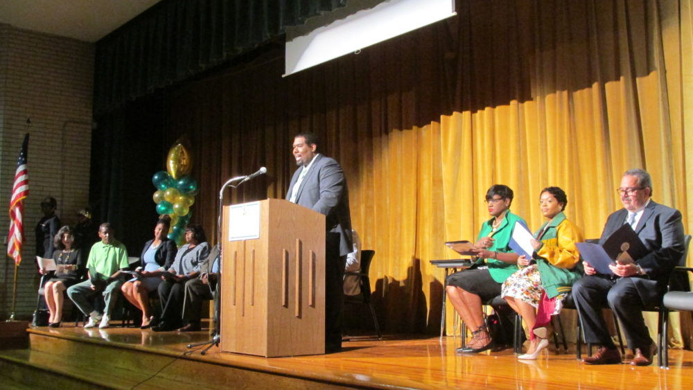 Principal Duane Clark welcomes guests to the grand opening of the new classroom wing at Worthing High School in Sunnyside.