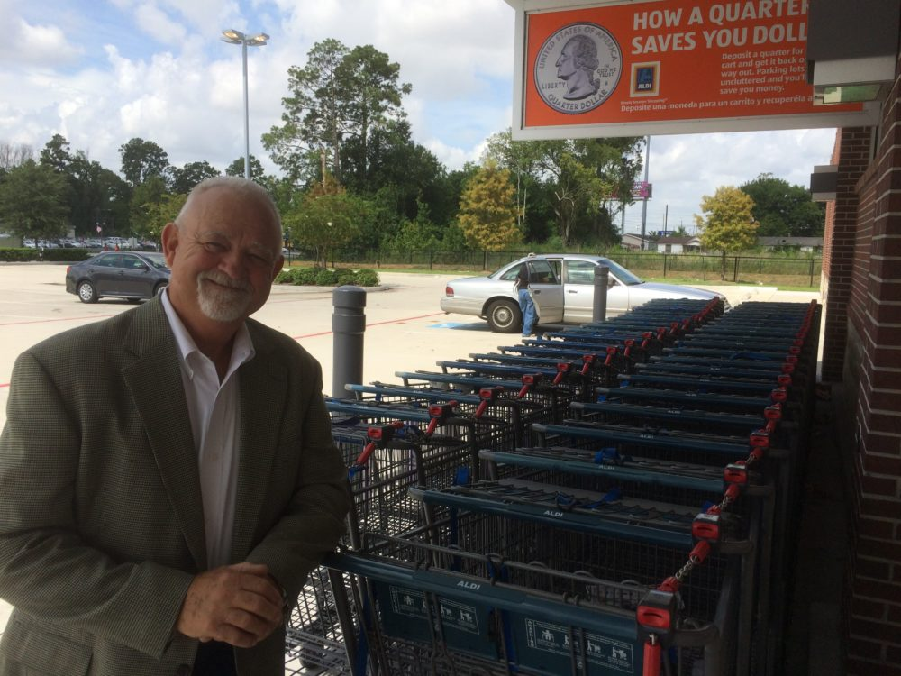 Joe Williams with the Texas Retailers Association stands in front of an Aldi. The grocery store chain requires a 25 cent deposit for its shopping carts.