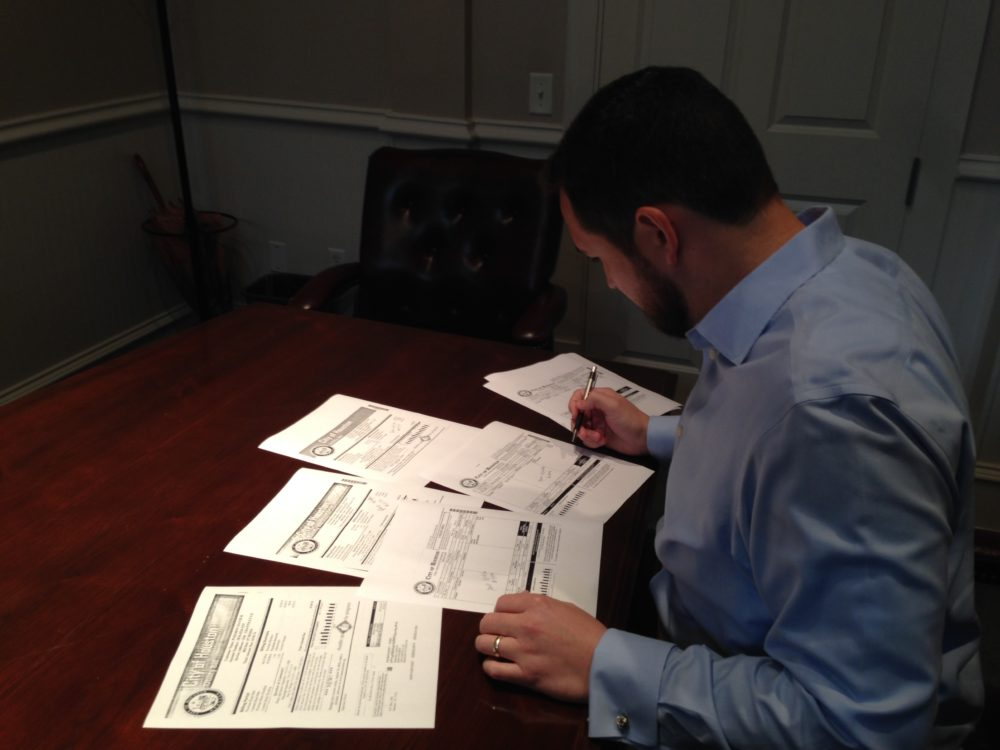 David Pokorny, a resident of the Oak Forest Neighborhood, reviews his water bills from the City of Houston. He has launched an online petition requesting that a third party inspects the water meters and reviews the accuracy of the billing process.