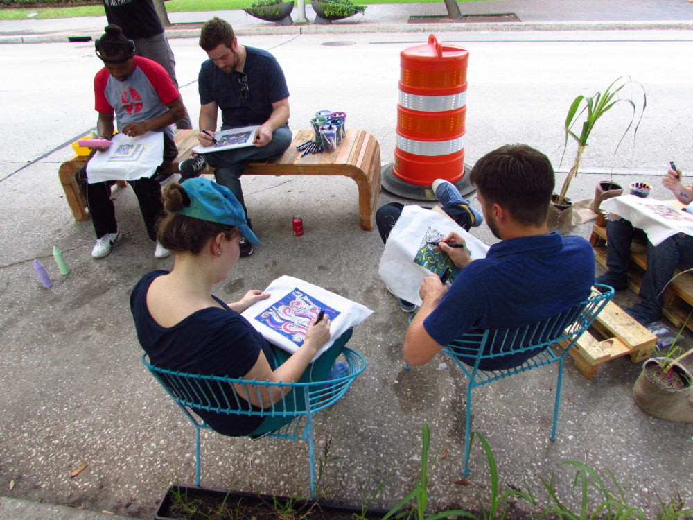 A parking space transformed into an art studio.