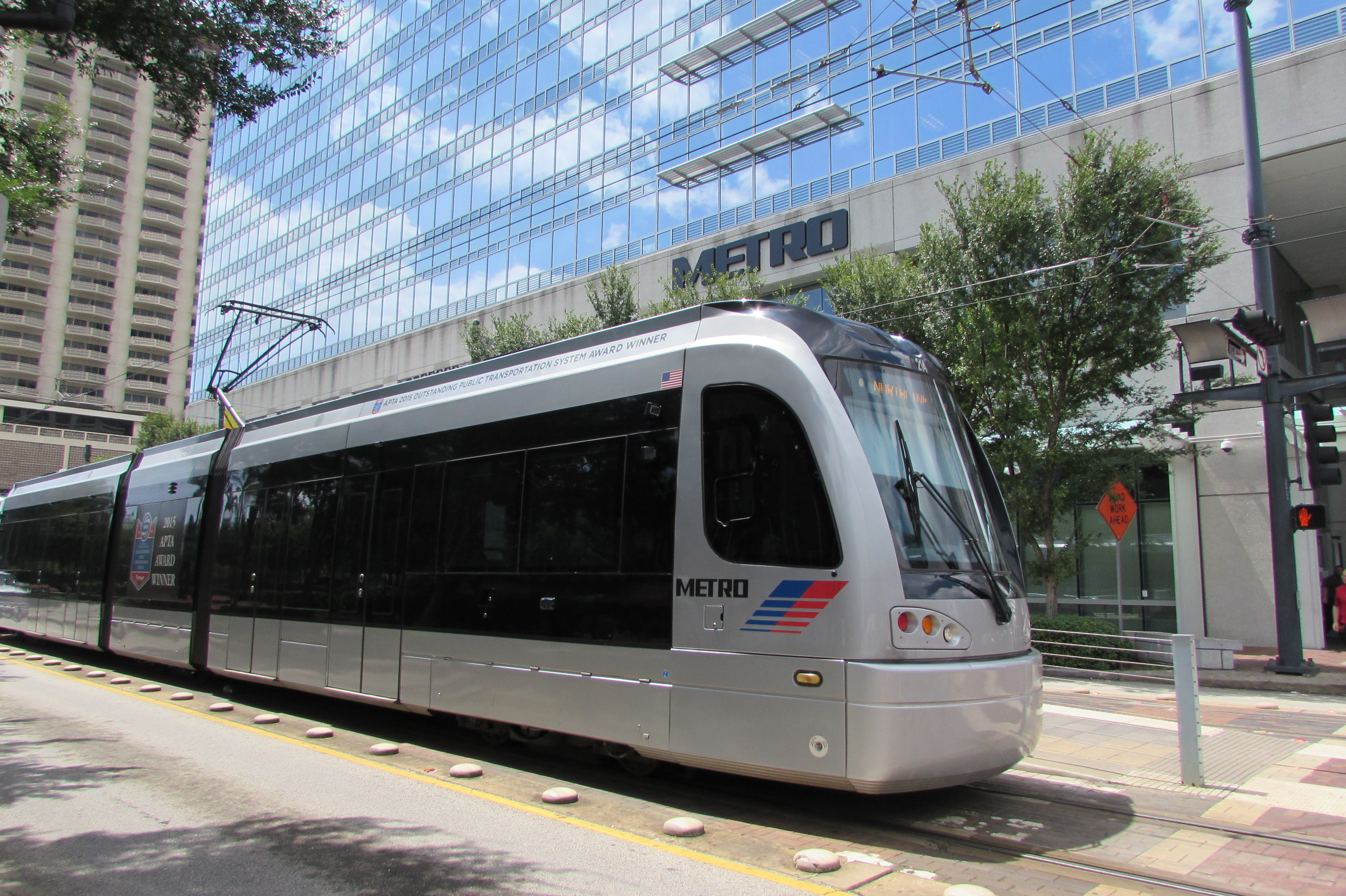 Light rail train in front of Metro's headquarters on Main Street.