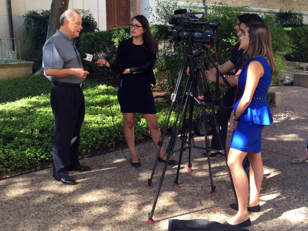 Texas Secretary of State Carlos Cascos with reporters from Spanish-language TV Telemundo and Univision talking about the VoteTexas campaign.