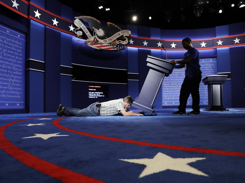 Technicians set up the stage for the Sept. 26 debate between Democratic presidential candidate Hillary Clinton and Republican presidential candidate Donald Trump at Hofstra University in Hempstead, N.Y.