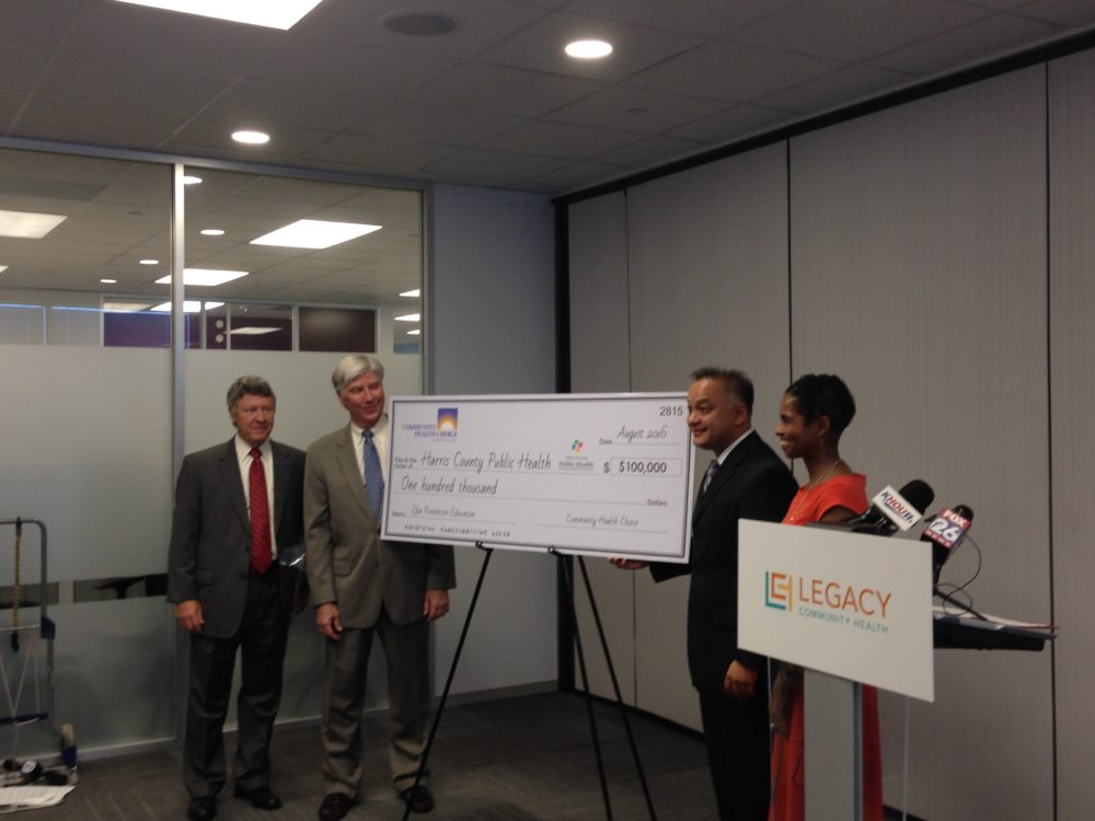 Ed Emmett, Harris County Judge; Ken Janda, CEO of Community Health Choice; Dr. Umair Shah, executive director of Harris County Public Health; and Doctor Ann Barnes, Chief Medical Officer at Legacy Community Health, attended a press conference held to announce the $100,000 donation from Community Health Choice to Harris County.