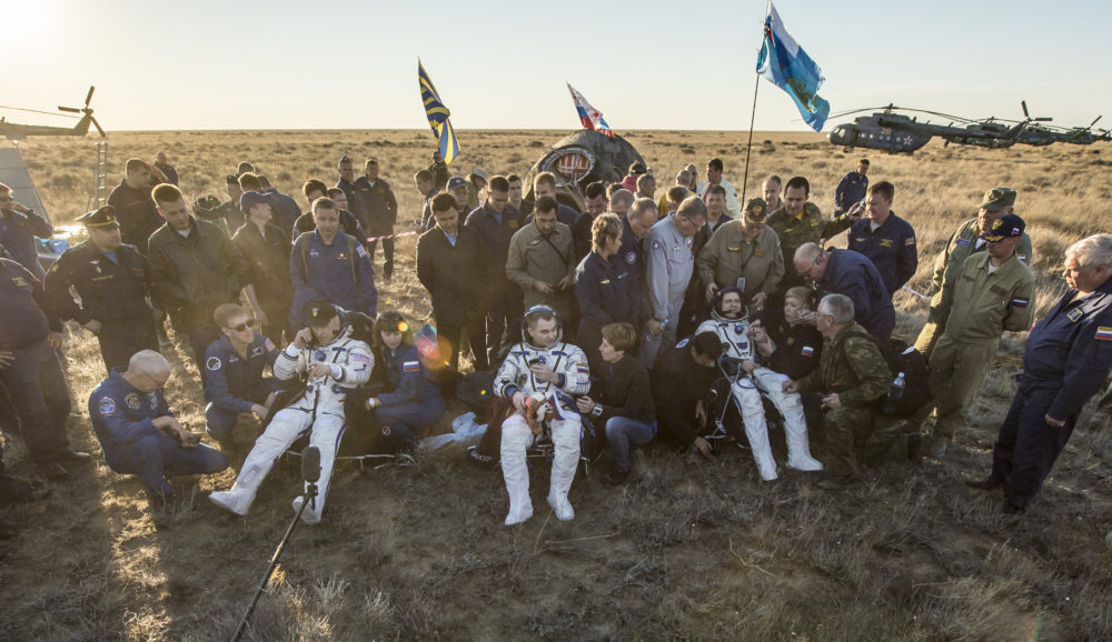 NASA astronaut Jeff Williams, left, Russian cosmonaut Alexey Ovchinin of Roscosmos, center, and Russian cosmonaut Oleg Skripochka of Roscosmos sit in chairs outside the Soyuz TMA-20M spacecraft a few moments after they landed in a remote area near the town of Zhezkazgan, Kazakhstan on Wednesday, Sept. 7, 2016(Kazakh time). Williams, Ovchinin, and Skripochka are returning after 172 days in space where they served as members of the Expedition 47 and 48 crews onboard the International Space Station.