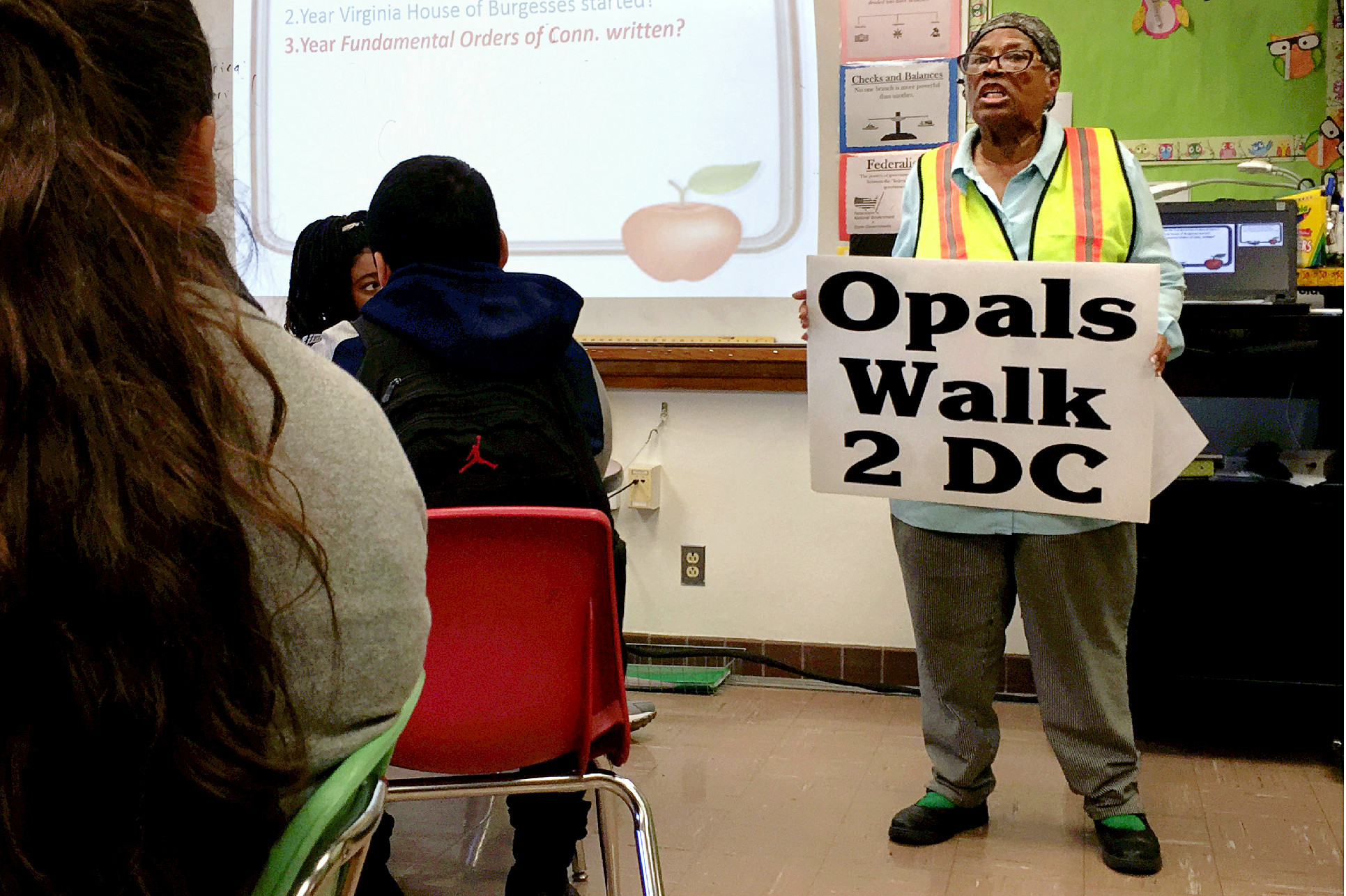 Opal Lee addresses students at E.B. Comstock Middle School.