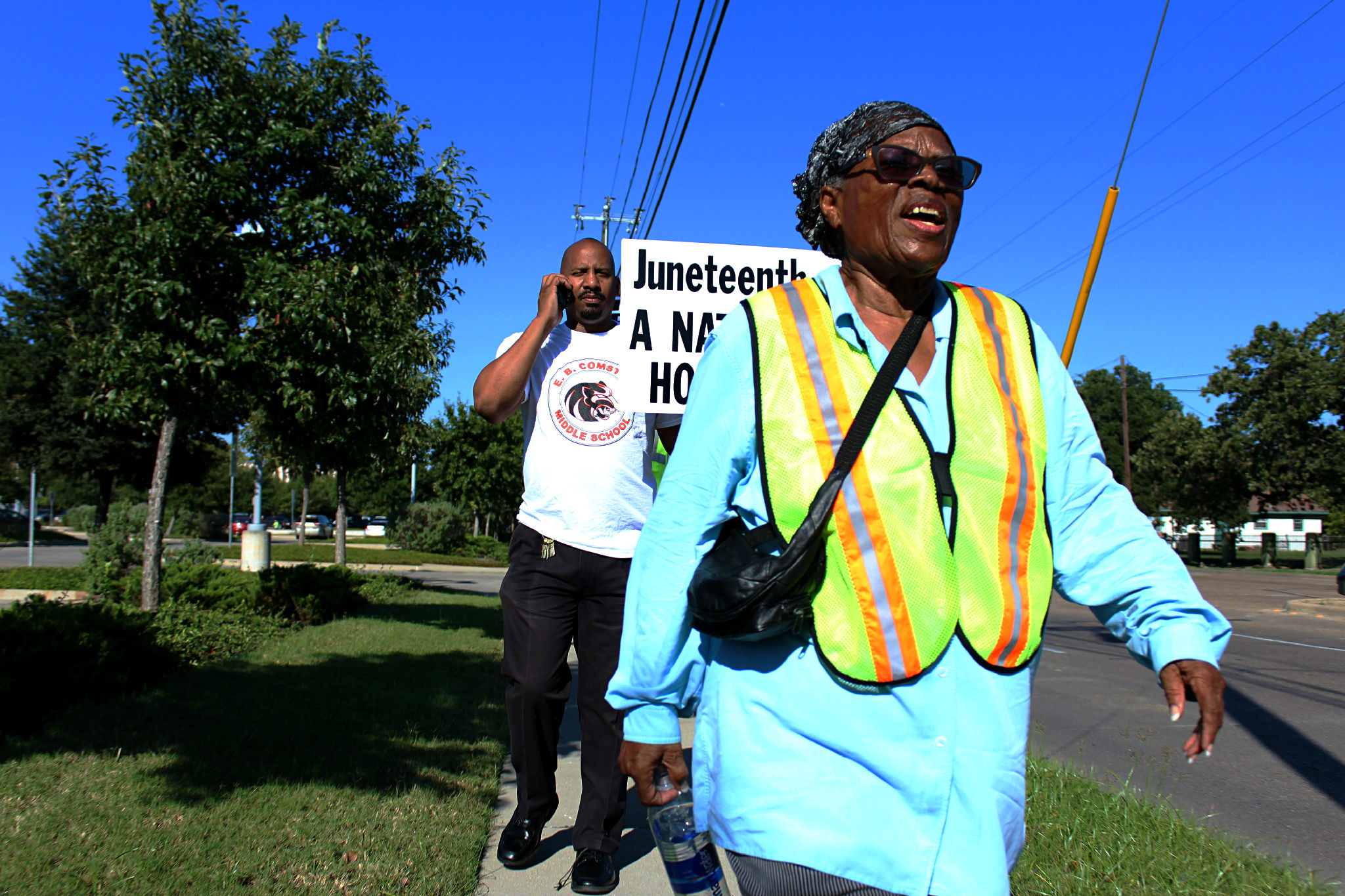 Opal Lee plans to turn 90 on her walk to the nation's capital. Behind her is Willie Johnson, principal of E.B. Comstock Middle School in Dallas, who joined her for a leg of the walk.