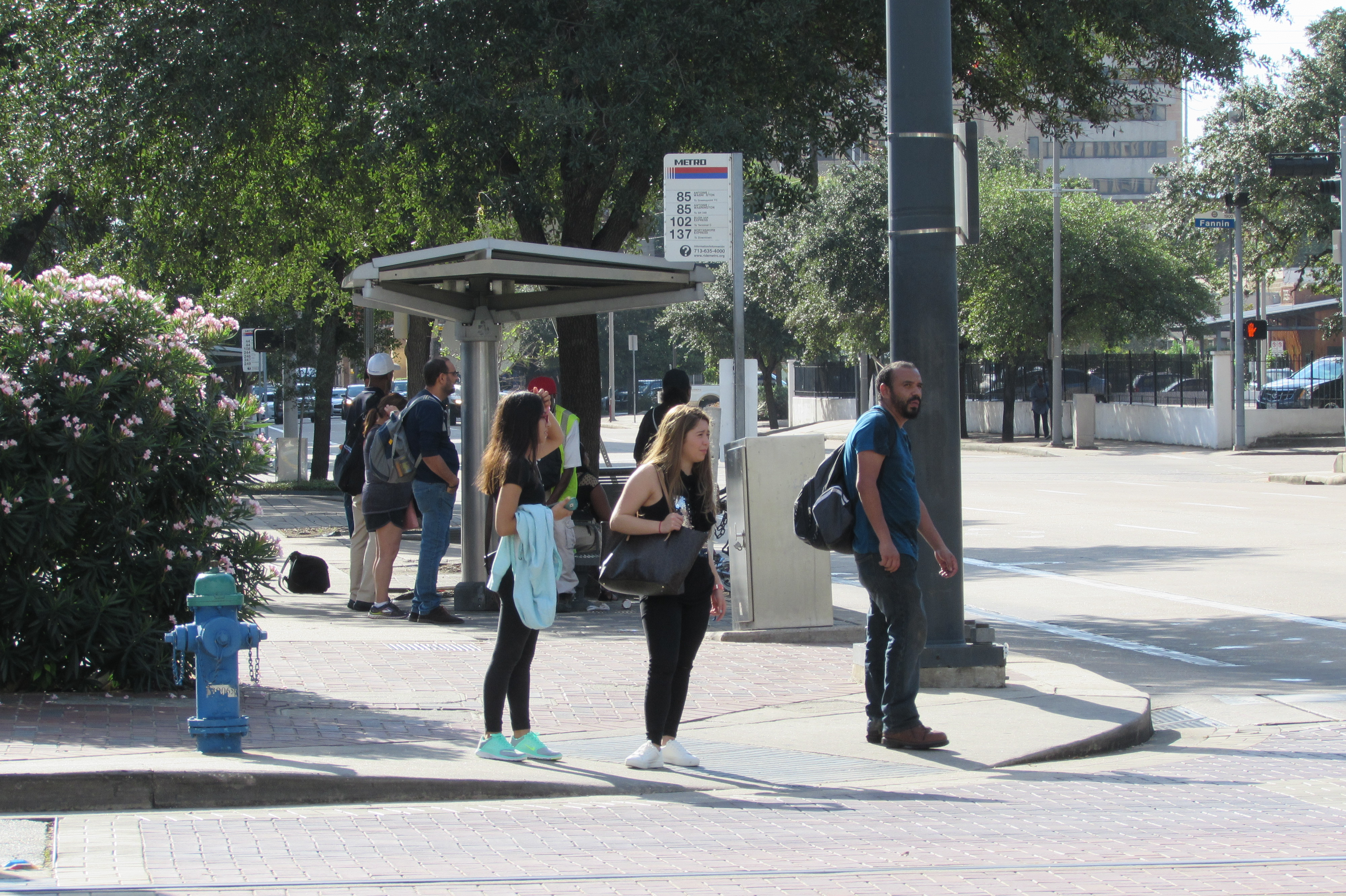 Riders wait for the bus near Metro's downtown headquarters.