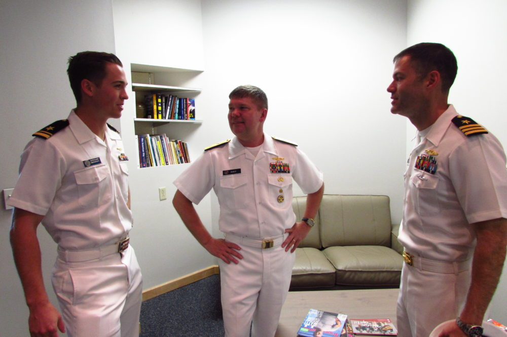 Navy personnel visiting Houston include (left to right) Lt. Clayton Callander, Rear Admiral Tom Ishee, and Commander Scott McGinnis.