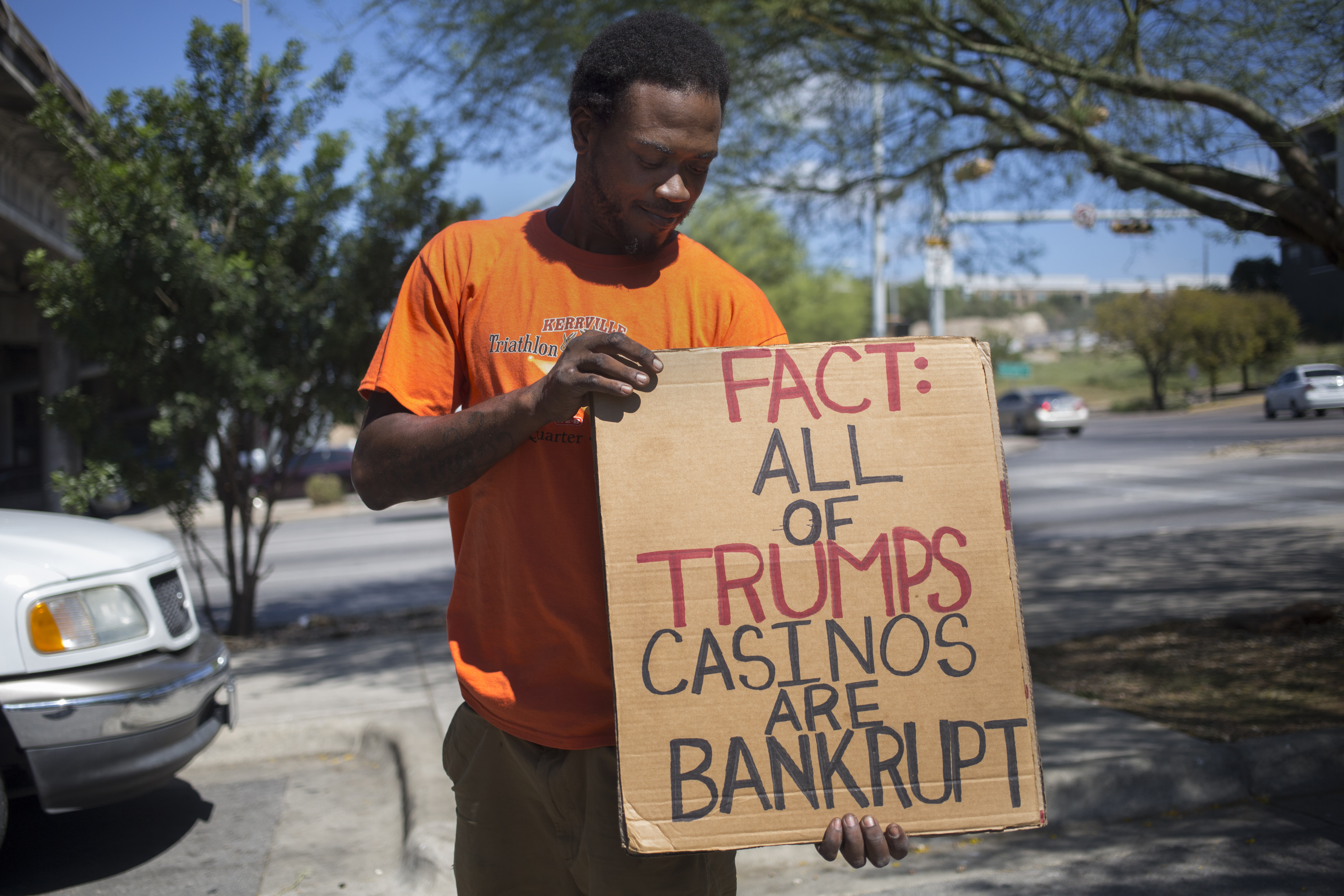 Zion Jeffamoff holding one of his anti-Trump signs near the intersection of Sixth Street and I-35 on October 5, 2016.