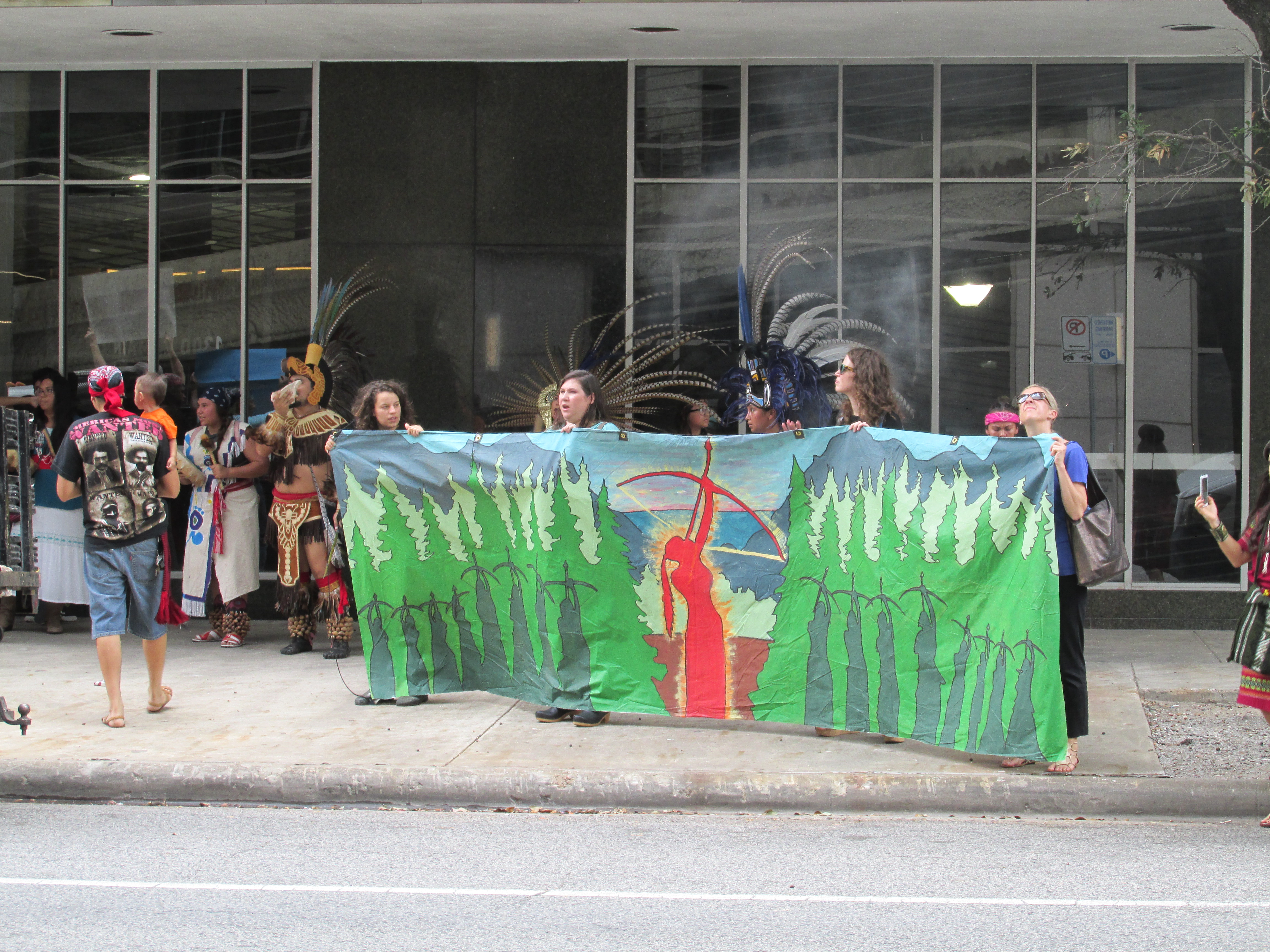 Indigenous and environmental activists rally outside the Houston offices of Energy Transfer Partners, which is building the controversial Dakota Access and Trans-Pecos pipelines.