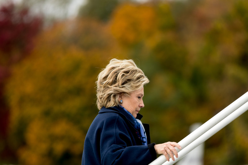 Hillary Clinton boards her campaign plane at Westchester County Airport in White Plains, N.Y., on Friday. The FBI said Friday it will be looking into newly discovered emails related to Clinton's private server.