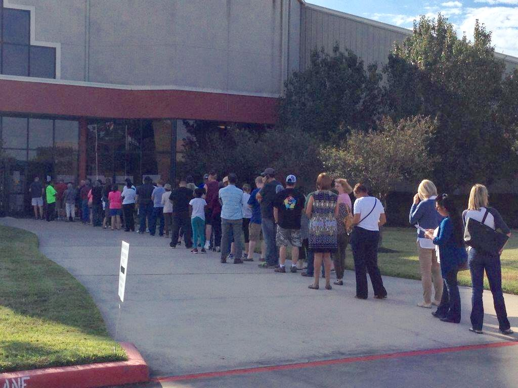 Voters lined up since 8:00 a.m. at the Champion Life Centre, in Spring, on Monday October 24th, first day of Early Voting,