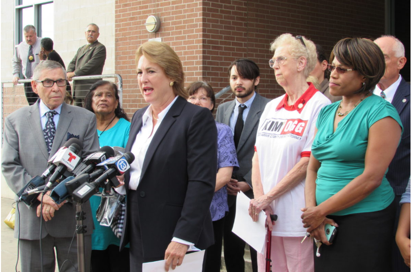 Kim Ogg gathered with supporters in July for a news conference outside the Harris County Jail.