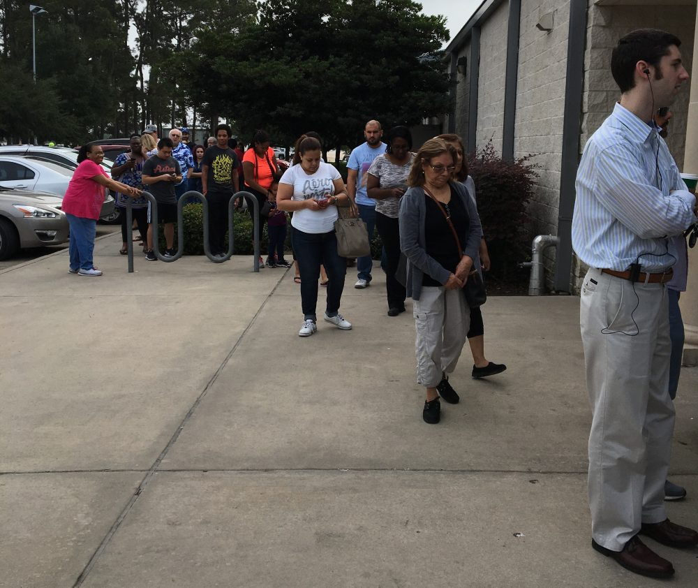 Voters stand in line to cast a ballot at an early voting location in Humble on November 4.