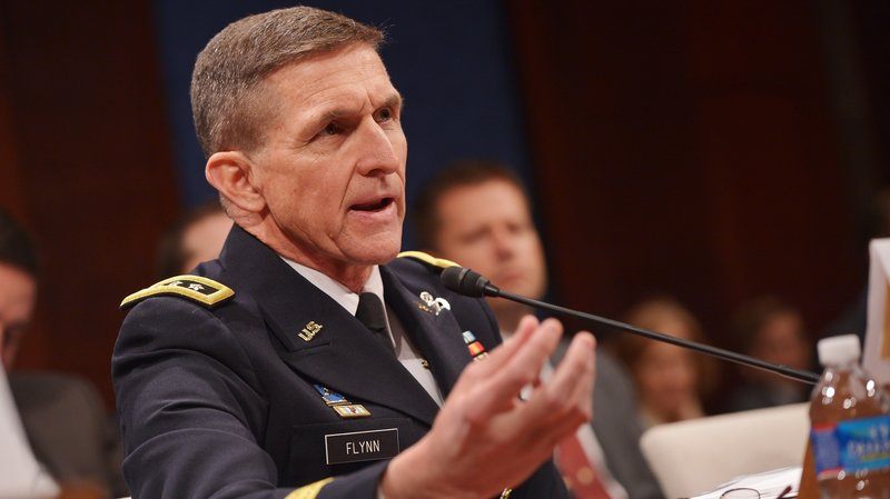 Then-Defense Intelligence Agency Director Lt. Gen. Michael Flynn testifies before the House Select Intelligence Committee in February 2014. He was forced out of that role later that year.