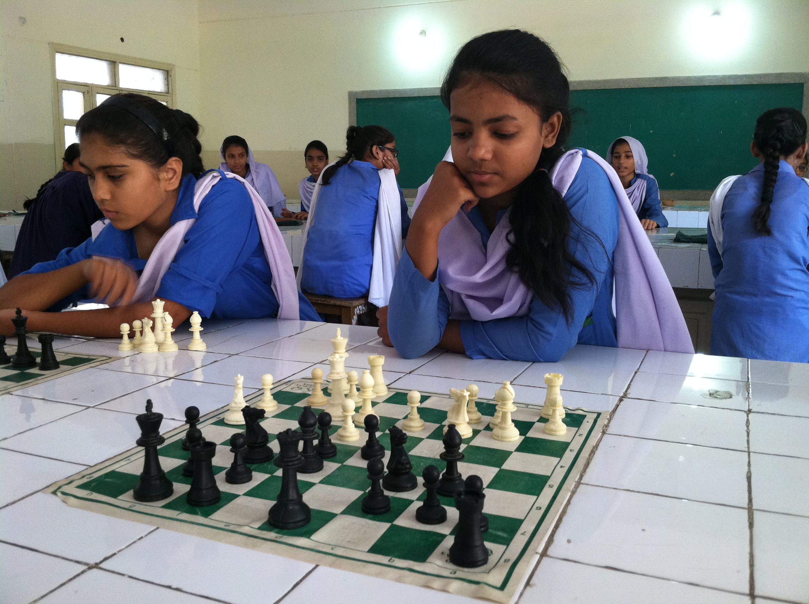 Girls study and compete in chess, just one of several extracurricular activities added to this girls' public school since the Zindagi Trust adopted it in 2007.
