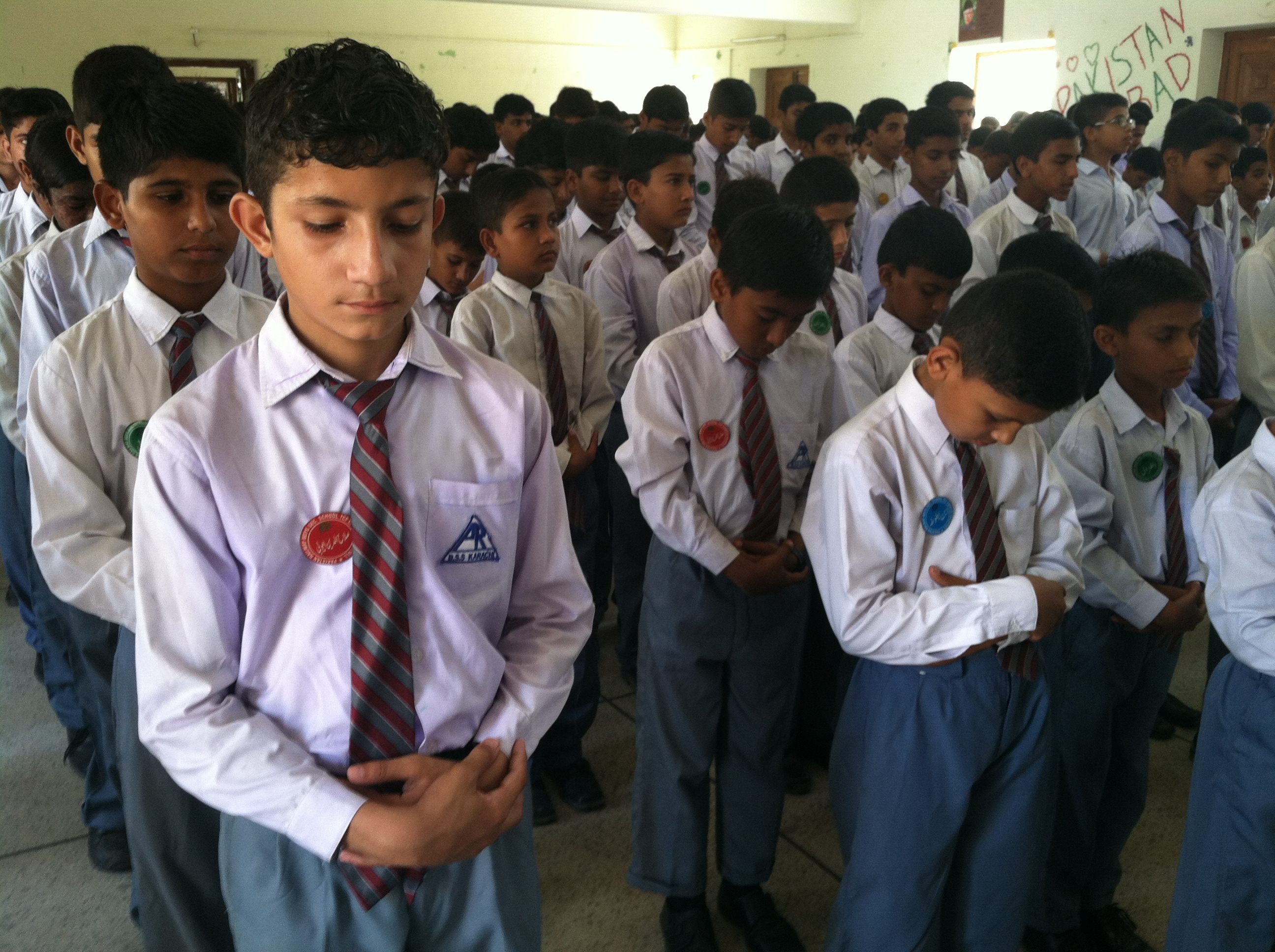 Middle and high school boys line up for the opening assembly with prayer and the pledge of allegiance at the Pakistani Railway School in Karachi, The school was adopted by the nonprofit, The Citizens Foundation, last year and has already seen a jump in test scores.