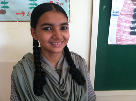 Rizwana Ruab, 16, attends the ninth grade at one of the schools with Developments in Literacy in Orangi. She is studying biology so she can become a police officer. She spends several hours every day making shoes with her family. She earns on average about 20 U.S. cents an hour.