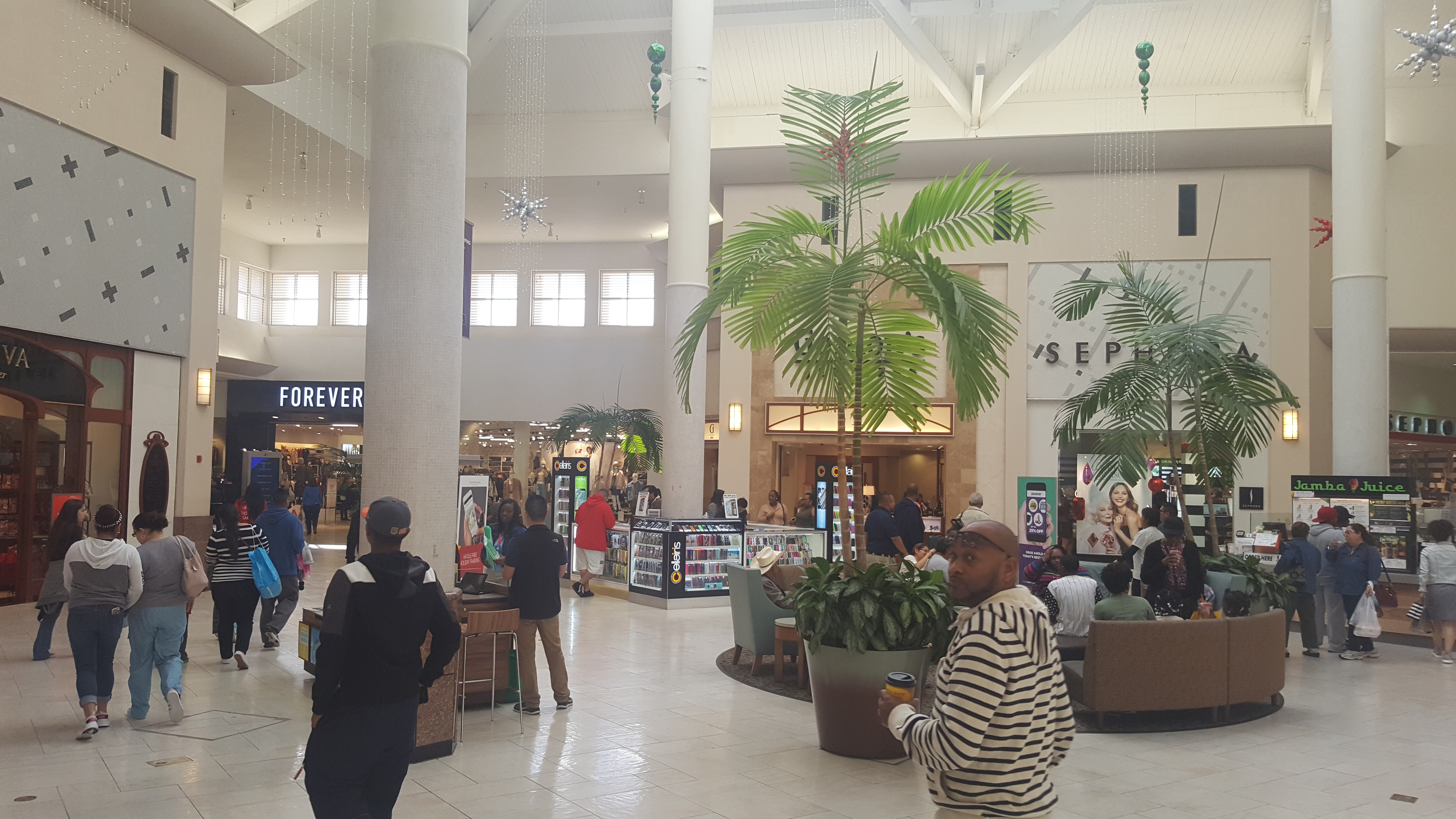 Shoppers walking around Willow Brook Mall in North West Houston.