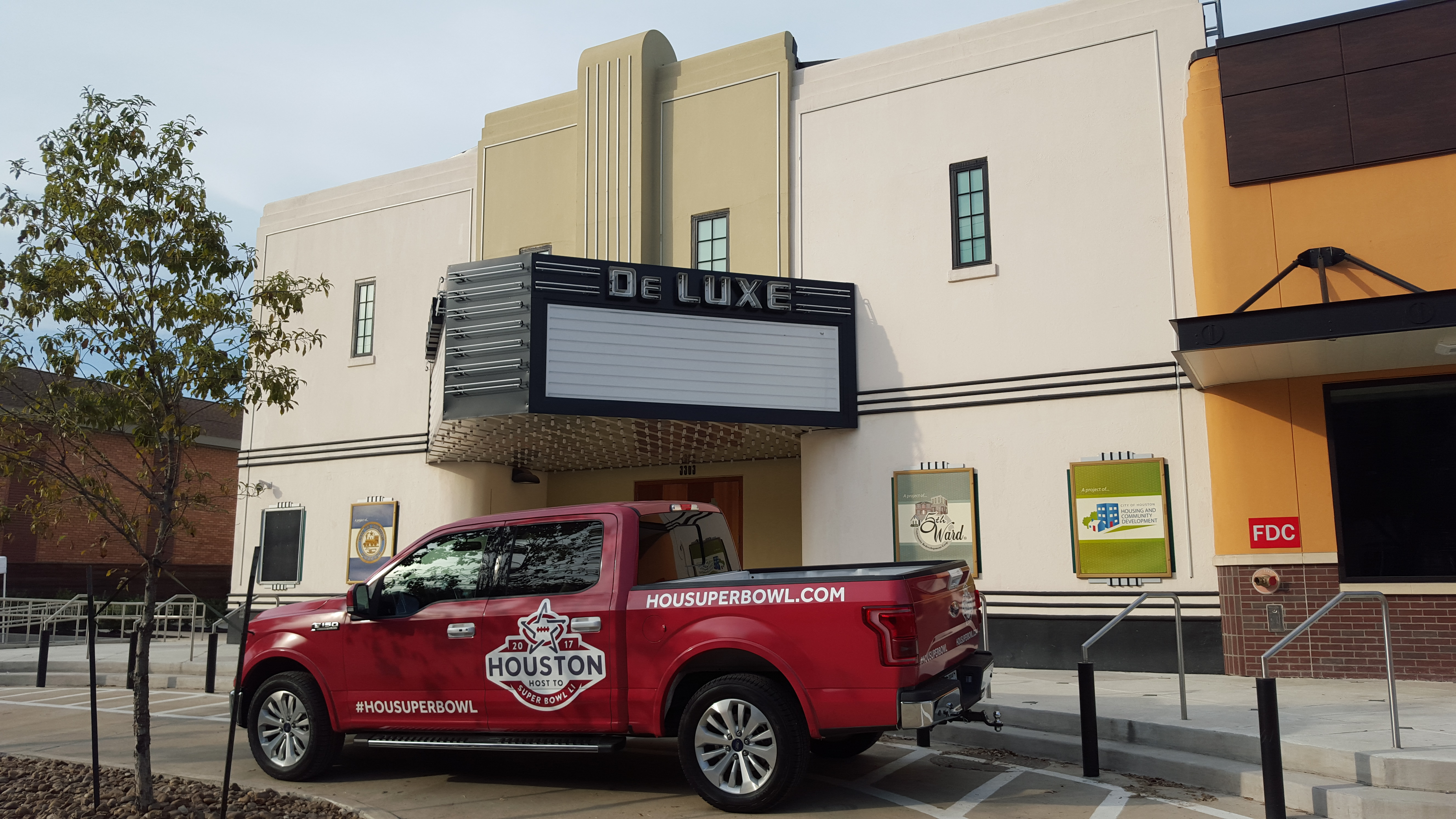 An official Super Bowl 51 vehicle at the Fifth Ward's historic DeLuxe Theatre.