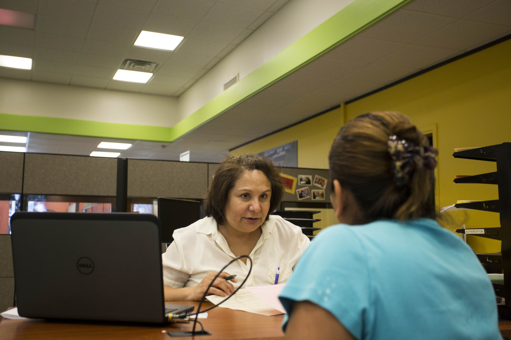 Nora Cadena, of Insure Central Texas at Foundation Communities, assists with enrollment in the Affordable Care Act at a Foundation Communities Community Tax Center in North Austin.