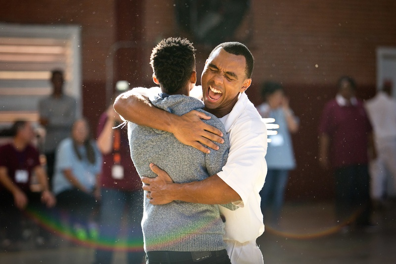John Green reunites with his son in the middle of the Darrington Unit gym at the start of the Day with Dad program, Saturday, Nov. 5, 2016. Children and the 29 participating inmates ran into each other's arms to kick off the day of activities.