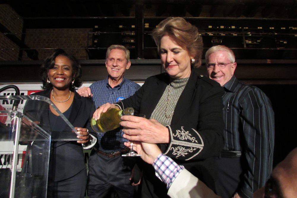 Kim Ogg has a champagne toast with supporters at her election night party in The Heights.