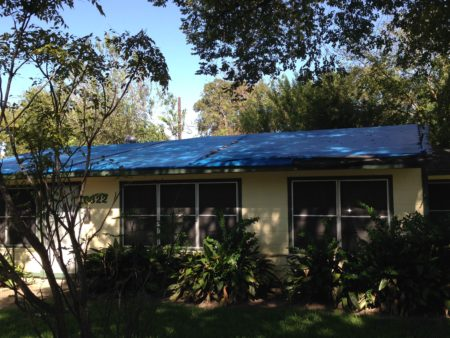 Tarps such as the one this photo shows covered the roof of Ms. Huff's home for eight years.