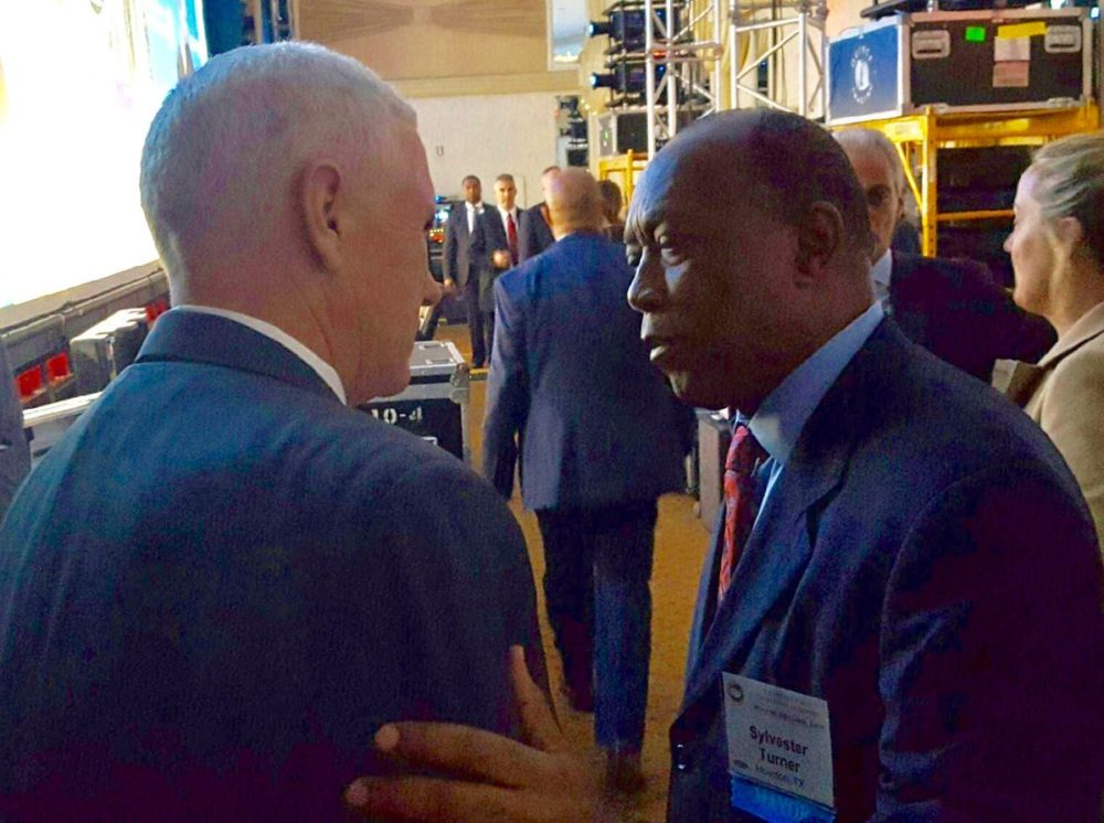 Houston Mayor Sylvester Turner speaks with Vice President-Elect Mike Pence during the 85th winter meeting of the U.S. Conference of Mayors, which took place in Washington, D.C.