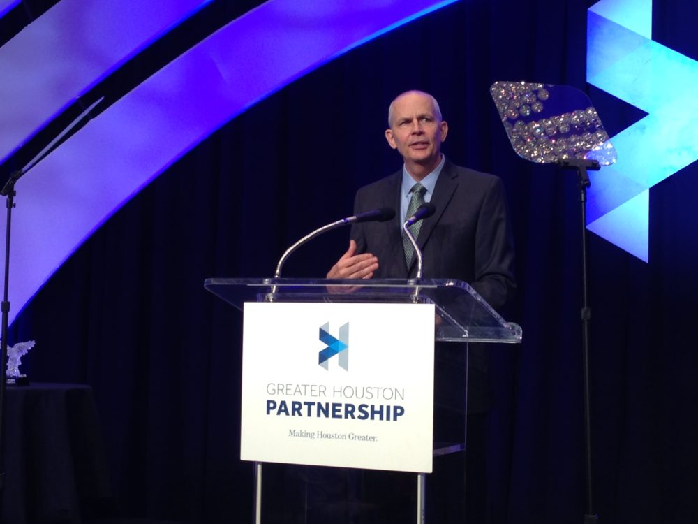 Jeff Shellebarger, the new chair of the Greater Houston Partnership, addressed a full room gathered at a downtown Houston hotel during the organization's annual meeting.