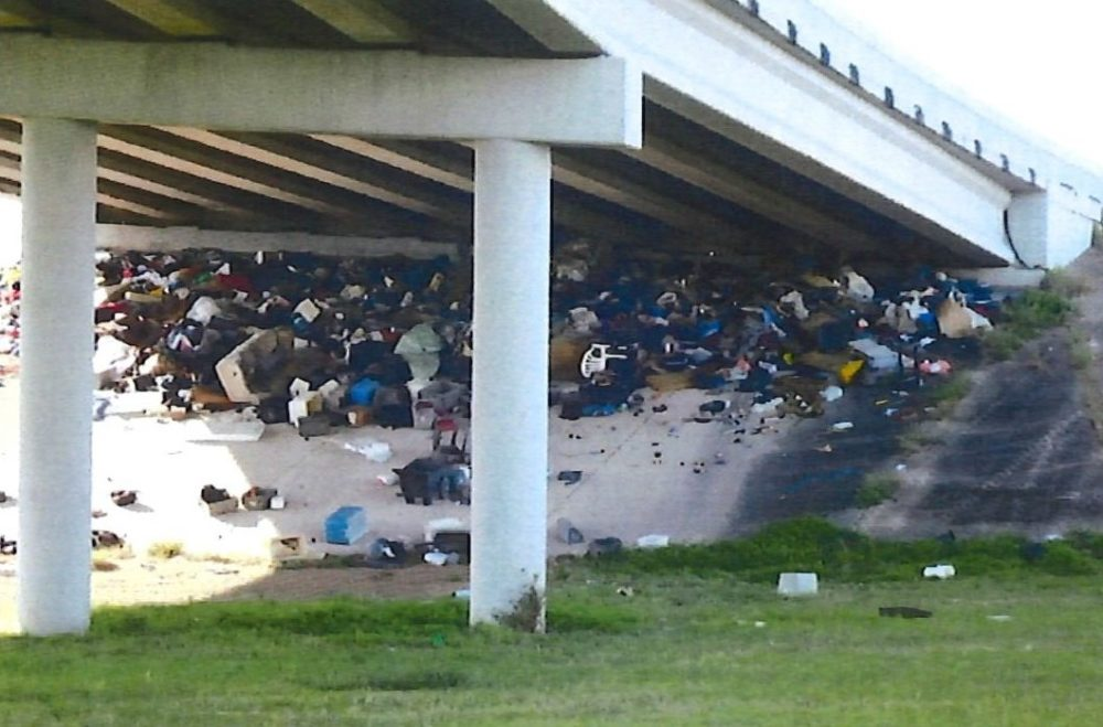 The HPD report indicates the intersection of South Main at Holmes is a dumping area for a homeless camp.