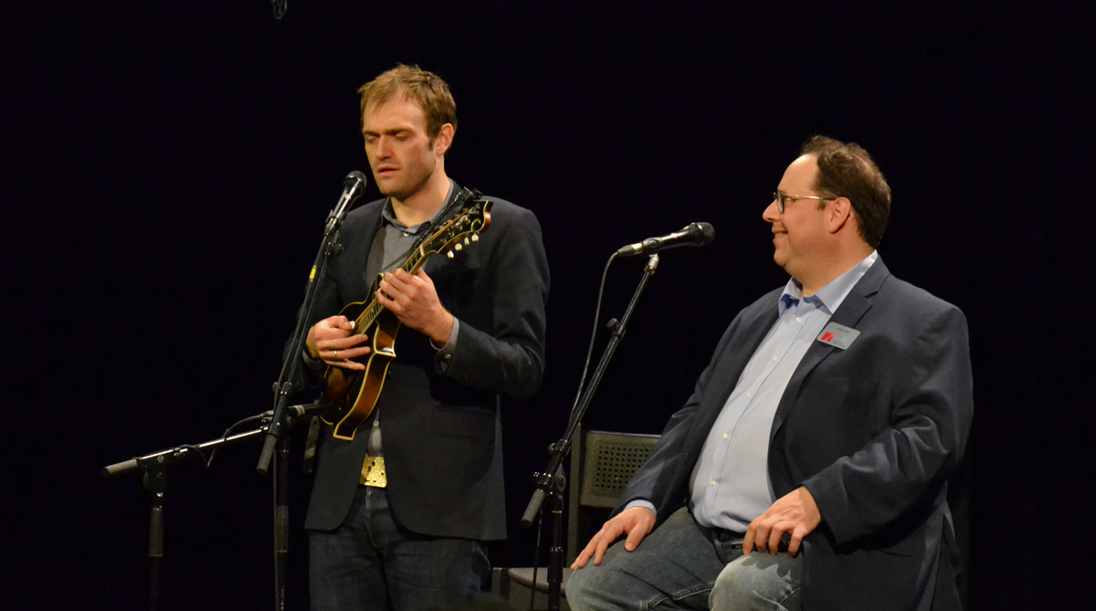 "Chris Thile, host of ""A Prairie Home Companion"" performs onstage as ""Houston Matters"" host Craig Cohen looks on. Thile performed at an event for Houston Public Media donors on Jan. 22, 2017. (Photo: Fujio Watanabe, Houston Public Media)"