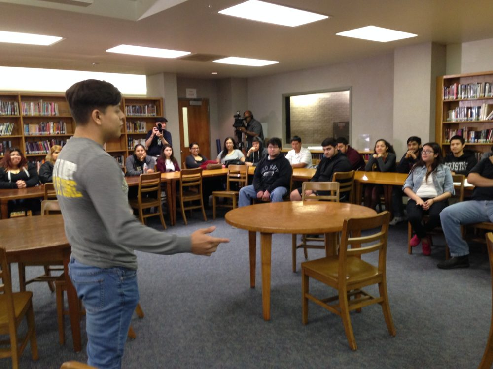 A student from HISD's Sam Houston Math, Science and Technology Center participates in a meeting held previously to the voter registration.
