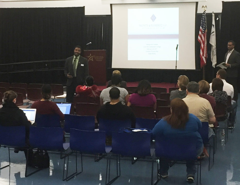 Lone Star College-Tomball Vice President of Instruction Dr. Quentin Wright welcomes attendees to the first of several immigration workshops being hosted by Lone Star College this week.