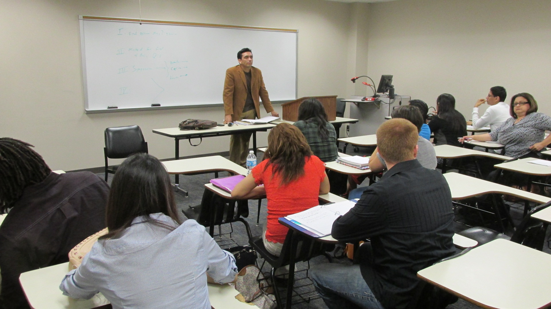 Tony Diaz, a professor at Lone Star College and also an activist with the group Librotraficante, says when students can relate more to a class, they are more engaged and do better academically. (Photo: Laura Isensee | Houston Public Media)