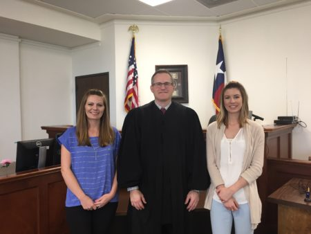 Program manager Kelli Wright, Judge Chad Bradshaw and supervision officer Meghan Ryan work at the Brazoria County Domestic Violence Court.