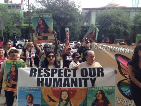 About 50 people marched through downtown Houston as part of the Caravan Against Fear to demand changes in the enforcement of immigration laws by the government.