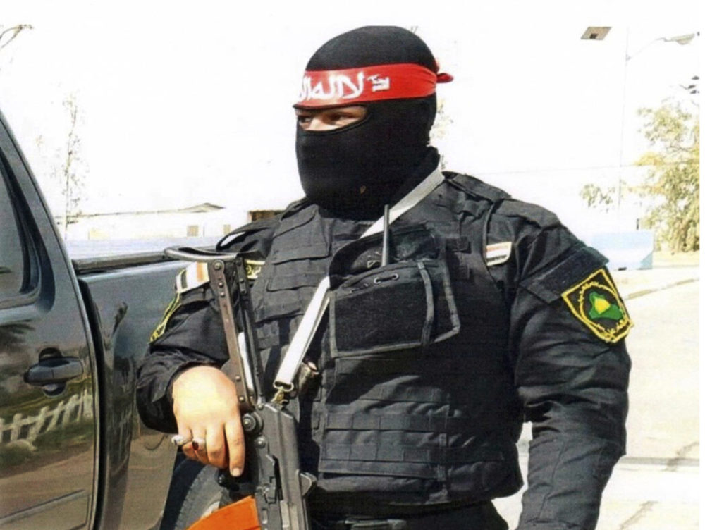 This undated photo obtained by the Associated Press shows an Iraqi bodyguard hired by Sallyport Global to protect VIPs. When a Toyota SUV was stolen from Balad air base, he became the chief suspect and was linked to a dangerous Iran-backed militia and was viewed by investigators as