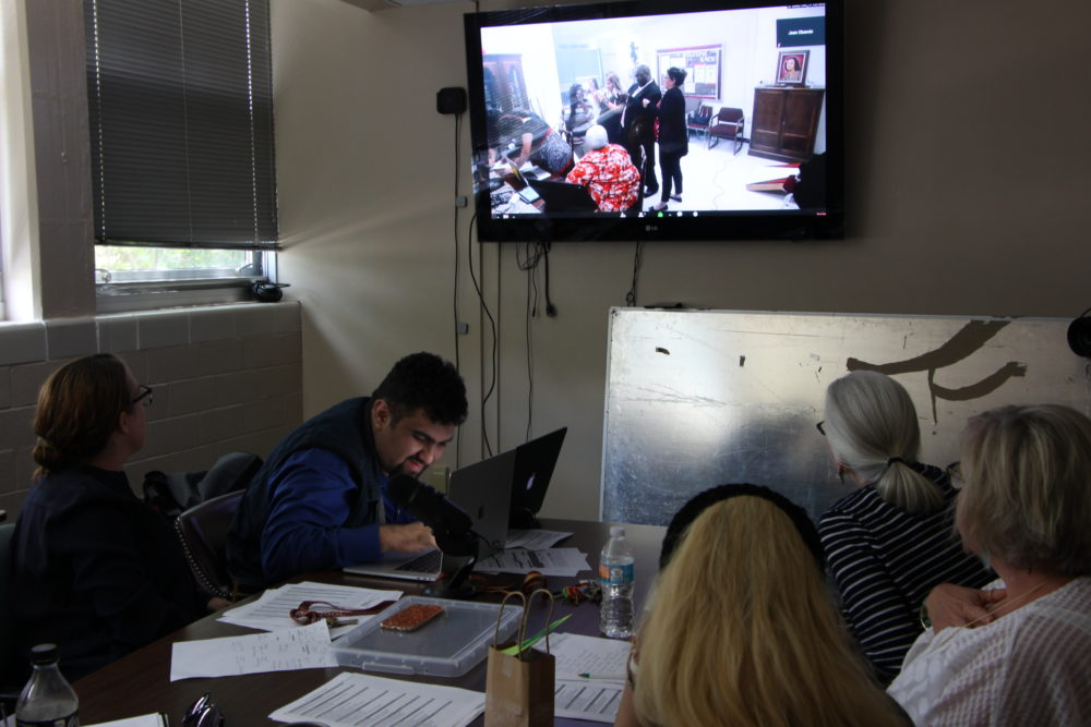 "Furr High School is experimenting with a new model for high school, including how they hire teachers. Here, administrators watched applicants on a live video feed as they tried to solve clues and ""escape the room"" during the interview process. (Photo: Laura Isensee, Houston Public Media)"
