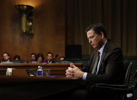 In this Wednesday, May 3, 2017, photo then-FBI Director James Comey pauses as he testifies on Capitol Hill in Washington, before a Senate Judiciary Committee hearing. President Donald Trump abruptly fired Comey on May 9, ousting the nation's top law enforcement official in the midst of an investigation into whether Trump's campaign had ties to Russia's election meddling.