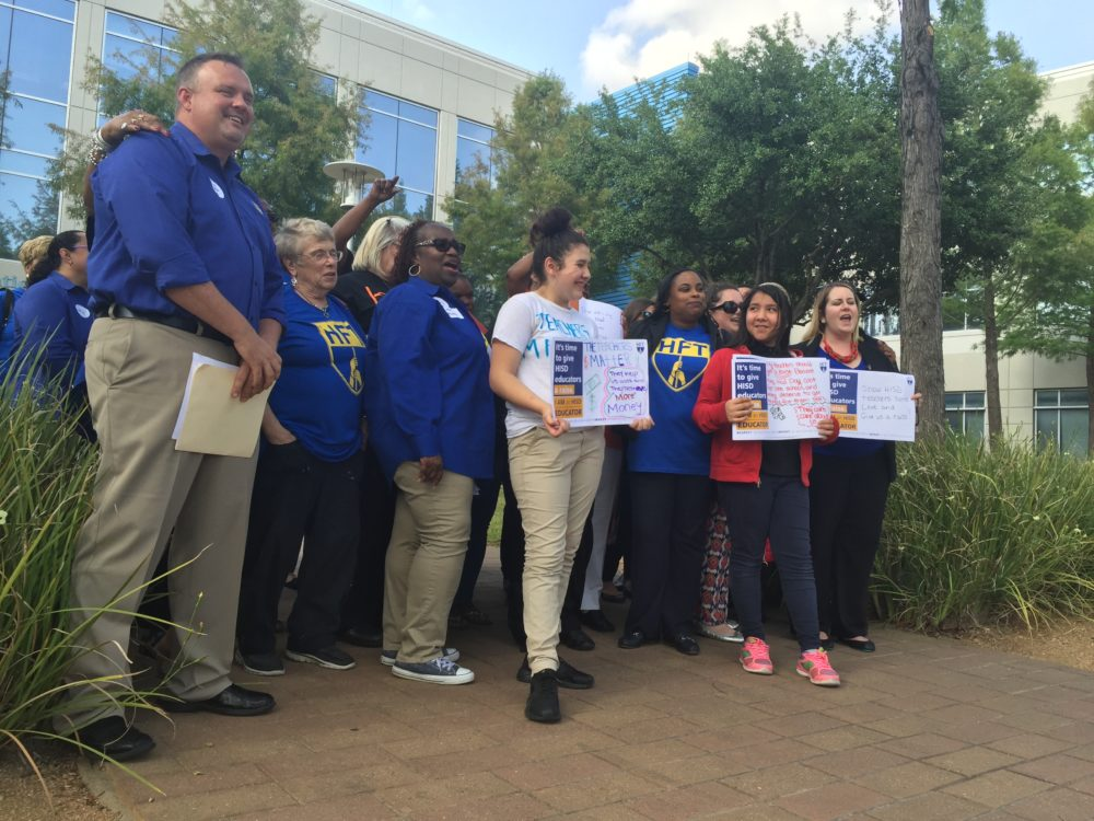 Teachers and school support staff rallied outside HISD headquarters to press for more competitive raises in next year's budget.
